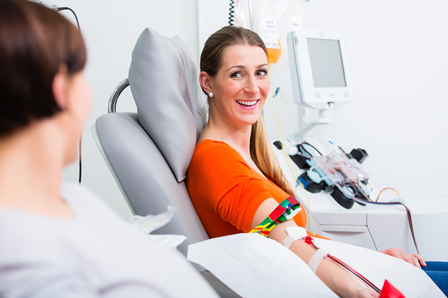 Woman smiling while giving blood