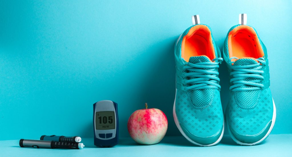 a line up of a pair of shoes, an apple, a pedometer