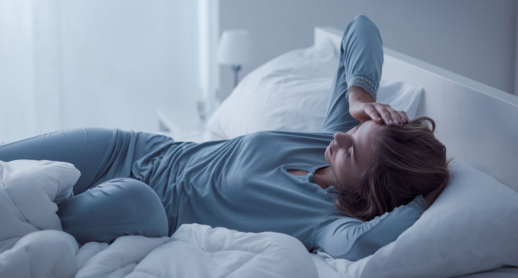 Fatigued woman in bed