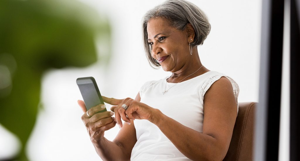 Women checking her phone for medical prognosis